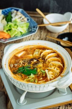Kimchi Gyoza Nabe is a happiness HotPot in the whole world! This hearty hot pot comes with gyoza (Japanese dumplings), Kimchi, and vegetables brings comfort instantly! Easy Japanese Recipes, Japanese Food, Asian Recipes, Ethnic Recipes, Chinese Recipes, Kimchi, Japanese Dumplings, Soup Recipes, Cooking Recipes