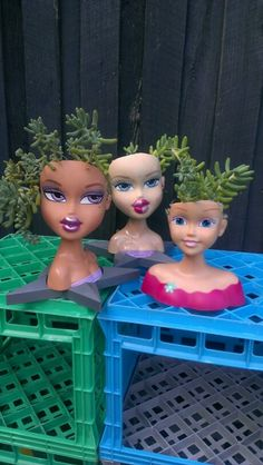 Scalping doll heads to make planters is fun... Made by julie caldwell, melb, australia.