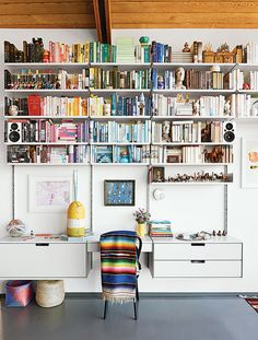 A 606 Universal Shelving System by Dieter Rams for Vitsœ is the perfect perch for a color-coded array of books in this midcentury L.A. home.  Photo by Spencer Lowell.   This originally appeared in Modern Renovation of a Midcentury House in Los Angeles.