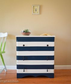 I like the way the stripes were painted,the drawers are disguised.