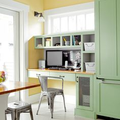 This family command center has one cubby per person, plus an extra to share. The perforated lower-cabinet front keeps computer equipment cool; wires and cables are hidden behind the walls.   Photo: Alex Hayden   thisoldhouse.com