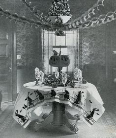 Take a look at this wonderful Halloween table and party decorations from yesteryear... Fascinating! Well done! I'd like to know the back story - who the party was for, who did the decorating, the year, etc. Love it.