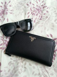 Prada wallet and Lanvin for HM sunglasses