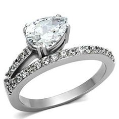 Pear Offset Engagement Ring - http://www.loveuniquerings.com/pear-shaped-engagement-rings/pear-offset-engagement-ring/