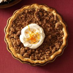 Orange Sweet Potato Pie with Ginger Streusel Recipe -Flecks of orange zest add a pleasant texture and zip to this classic sweet potato pie. Cook and mash the potatoes a day ahead to save time on pie-making day. —Lindsey Cook, Dallas, Texas