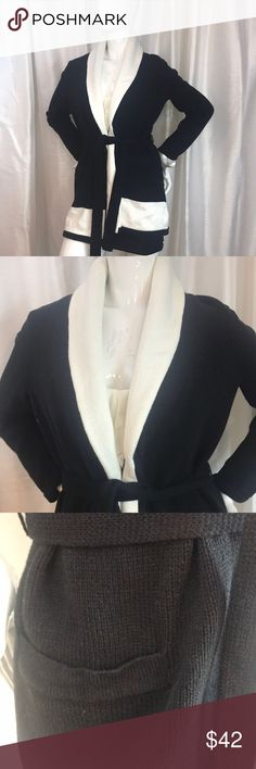 """Ralph Lauren Belted Sweater Cardigan Ralph Lauren Belted Sweater Cardigan. Size M. Never worn-pockets still sewn closed. Black with white collar and trim. Belted at waist, cuffed sleeves. Length is 28"""" Lauren Ralph Lauren Sweaters Cardigans"""