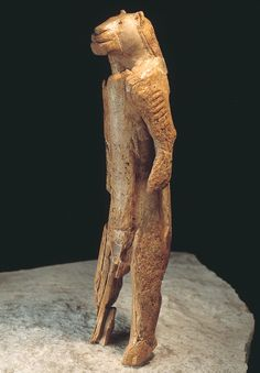 """""""Lion Man"""" is an ancient figurine sculpted from a mammoth's tusk 40,000 years ago. It was discovered at the back of the Stadel Cave in the Swabian Alps in Germany in 1939, broken into 200 pieces. Experts re-assembled it in 1970. Further fragments were later found among the previously excavated material and these were added to the figure in 1989. As of 2013, it is the oldest sculpture ever found."""