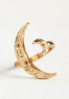 A dainty dual crescent moon ring that'll complete any outfit.