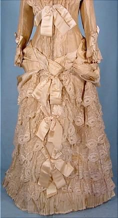 1883 STERN BROS. Wedding Gown of Cream Grenadine and Lace with Satin Ribbons