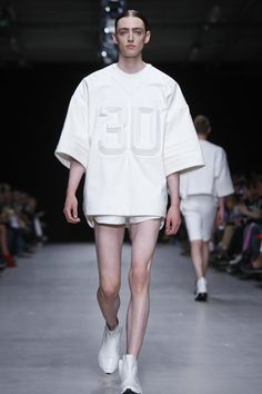 "Designer Juun.J titled his spring/summer 2014 menswear show ""UNUNIFORM"". The concept of the collection, according to the show notes, was for the house to disintegrate ""the barrier of the 'familiar'..."