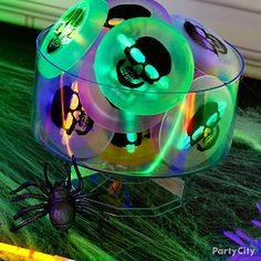 Rev up your trick-or-treaters (or have them work off some sugar!) with glow-in-the-dark toys! These skull discs have mini glow sticks in the back so you can see your monsters' mischief-making in the dark. Click the pic to see more glow-in-the-dark favors from Party City!
