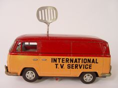 International TV Service  Tin Litho Battery Operated VW Bus Works well, lights up ON THE AIR with antenna. Good condition - some rust see pics. No markings.