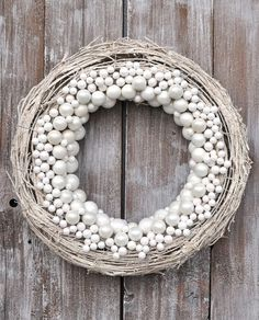 Spray (sponge?) a grapevine wreath white, add white pearl, crystal and mercury glass