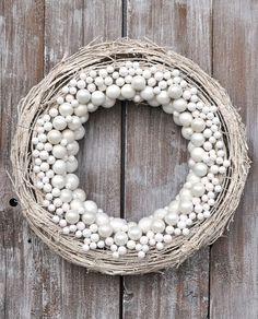 Spray (sponge?) a grapevine wreath white, add white pearl, crystal and mercury glass