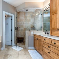 Spa-like en suite bath with separate soaking tub, stall shower with frameless glass door, dual sinks and custom wood vanities. Listed in Vienna Virginia by The Casey Samson Team is a Wall Street Journal Top Team in Northern Virginia.