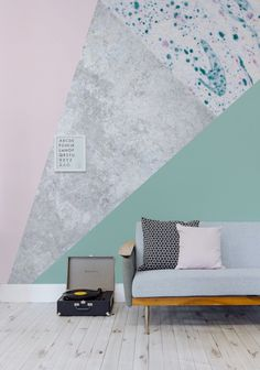 Forest green melts into blush pink to give a stunning contrast of colours. The metallic gold in this design wallpaper mural helps to tie this living room together perfectly.