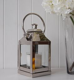 A chrome effect hurricane lantern from The White Lighthouse