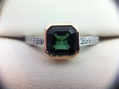 Asscher cut Green Tourmaline set in rose gold with diamond set shoulders in white gold - Flawless Jewellery