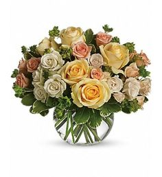 Send your loved one a magic moment with this gorgeous bouquet of spring roses! This assorted rose arrangement is a wonderful  'just because ' gift, sure to brighten her day and lift her spirits. Unique roses - yellow, peach and white - are arranged with bupleurum and variegated pittosporum in a clear glass bubble bowl.