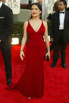 Who: Salma Hayek What: Narciso Rodriguez When: 2003 Why: A) Girl, look at that body. B) This is why more people should wear Narciso—he won't turn you into Salma Hayek, but he's going to make you *look* like the Salma Hayek-iest you possible. Elegant Dresses, Nice Dresses, Formal Dresses, Elie Saab, Salma Hayek Style, Miroslava Duma, Golden Globes, Red Carpet Looks, Red Carpet Dresses