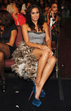 Image from http://realitytvfashion.com/wp-content/uploads/2012/10/Laura-Govan-Black-Girls-Rock-Corset-Feather-Dress.jpg.