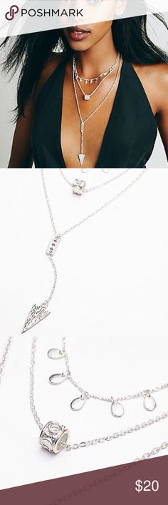 """Free People Stardust tiered necklace silver Free People STARDUST TIERED NECKLACE - Triple tiered long necklace featuring different layers of charm accents. - NEW with TAGS - DETAILS: • Retail $38 • Color: Silver • Style #35421155 • Lobster clasp closure • 17""""L • Metal • Import. Free People Jewelry Necklaces"""