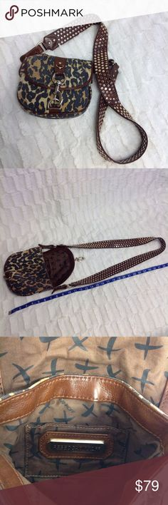 "REBECCA MINKOFF Crossbody Pu70 🎀🎀This fun Rebecca Minkoff bag is an animal print on canvas! The strap is a wide 1.75"" brown leather with gold studs, double sided. The front has a large clasp close statement. Inside has 1 open card slot. ***Pre-loved. Canvas shows some wear on front edges of flap. Leather trim and strap shoes very little imperfection. The front of class has slight scratching.  Priced accordingly! Rebecca Minkoff Bags Crossbody Bags"