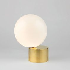 This spherical lamp looks like it is about to tip off the edge of its base.