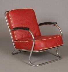 Wolfgang Hoffmann for Howell Art Deco tubular chrome arm chair with original cushions.