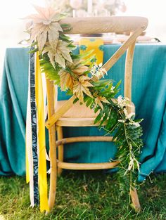 Photography: Katie Stoops Photography - katiestoops.com LOVE this idea for the chairs with ferns  Read More: http://www.stylemepretty.com/2015/02/20/rustic-chic-wedding-inspiration-at-verulam-farm/