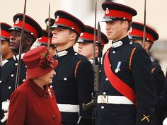 William can't help but crack a smile as his grandmother, Queen Elizabeth II, inspects him and his fellow graduates from the Royal Military Academy in Sandhurst, England, on December 15, 2006. His completion makes him a member of the Household Cavalry's Blues and Royals.