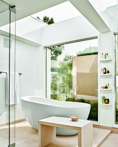 A retractable glass roof crowns the master bath; the tub is by Waterworks, and the limestone bench was custom designed by and Matt Flynn. See the rest of West LA home in Bathroom Remodel Shower, Home, Remodel, Home Remodeling, Small Bathroom, Bath Inspiration, Los Angeles Homes, Bathroom Design, Architectural Digest