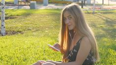 Young Woman On Grass With Phone #Adult, #Attractive, #Beautiful, #Casual, #Chizheffsky, #Communication, #Grass, #Headphones, #Leisure, #One, #People, #Person, #Phone, #Summer, #Woman, #Young https://goo.gl/2HxOY0