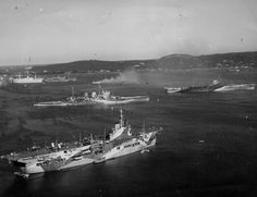 Trincomalee Harbour, Ceylon (now Sri Lanka); February carrier HMS Unicorn is in the foreground, with battlecruiser HMS Renown and carrier HMS Illustrious behind. Royal Navy Aircraft Carriers, Navy Carriers, Naval History, Military History, Hms Illustrious, Deck Maintenance, Dazzle Camouflage, Capital Ship, Navy Ships
