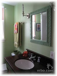 add some dark aspects and shiny new faucets to green and pink bathrooms?