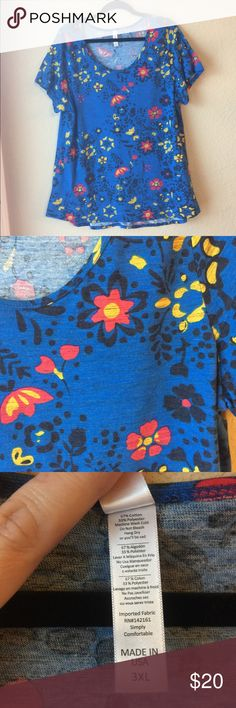 LuLaRoe Classic Tee LuLaRoe Classic Tee. Size 3X. New without tags. Blue background with black micro-stripes. Black, dark pink and yellow flowers. New without tags. Offers welcome! Thanks for stopping by. 🙂 LuLaRoe Tops Tees - Short Sleeve