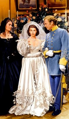 Scarlett's in her Mother's wedding dress, with Charles Hamilton and her Mother.