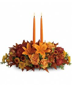 As your loved ones gather around the table, they'll bask in the warm glow of two orange taper candles surrounded by a fantastic array of #fallflowers.