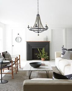 FREE SHIPPING. Purchase the 6 light Nori Chandelier in black Dark Weathered Zinc and Driftwood Grey faux wood beads for your beautiful rustic-chic dining room or living room lighting today at lightingconnection.com. Feiss F3129/6DWZ/DWG