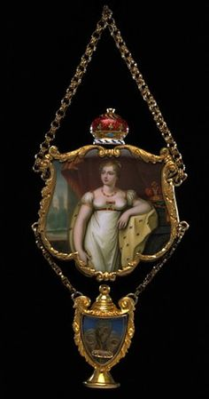 Princess Charlotte memorial pendant, 1817, gold, enamel, rock crystal and locks of her hair curled into Prince of Wales feathers, miniature by Charlotte Jones