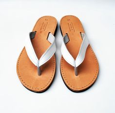 The best flip flops I've ever owned. And they're hand made to fit, so they are completely perfect. White Flip Flops, Greek Sandals