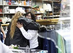 Maria Galvan is hugged by an unidentified woman after an explosion at a fertilizer facility damaged the West Thrift Shop where she has worked for 17 years in the town of West, TX. (Mike Stone / Reuters)
