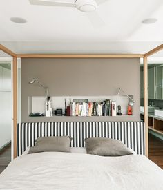 An Alcova bed from B&B Italia dominates the master bedroom. A niche behind the bed holds Berenice wall lamps by Luceplan, and the wal...