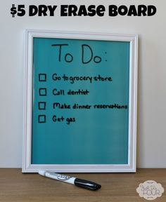 Super easy and inexpensive DIY Dry Erase Board idea. Only $5 to make.  JustUsFourBlog.com