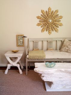 Gorgeous living room with French Directoire Settee and large gold sunburst mirror.