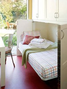 ... could even put a work table in front of doors when bed not in use. Also good for very small, dual purpose bedroom .... another idea: only bottom half built under a window? When closed it would look like a table? Maybe an arrangement on top that could move to a night stand when in use...