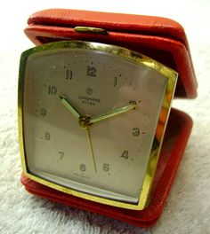 This gorgeous travelling alarm clock was made by Junghans, Germany and is in perfect working order - from HobartCollectables.