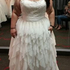 This plus size bride choose a lace bodice with a tiered ruffle skirt.  You can customize any dress design however you want at Darius Cordell.  Get pricing on custom #weddingdresses & replicas when you visit our main website.