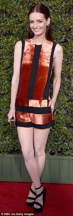 Bold look: Lydia Hearst wowed in an orange and black shimmering dress, pairing it with sky high strappy heels