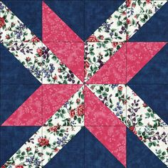 Quilt kit features beautiful Lily of the Valley and trumpet flowers in tones of pink, blue and plum along with green stems and leaves on a white background. A nice raspberry pink tonal and dark navy b